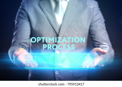 Business, Technology, Internet and network concept. Young business man, working on the tablet of the future, select on the virtual display: optimization process.
