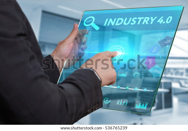Business, Technology, Internet and network concept. Business man working on the tablet of the future, select on the virtual display: industry 4.0