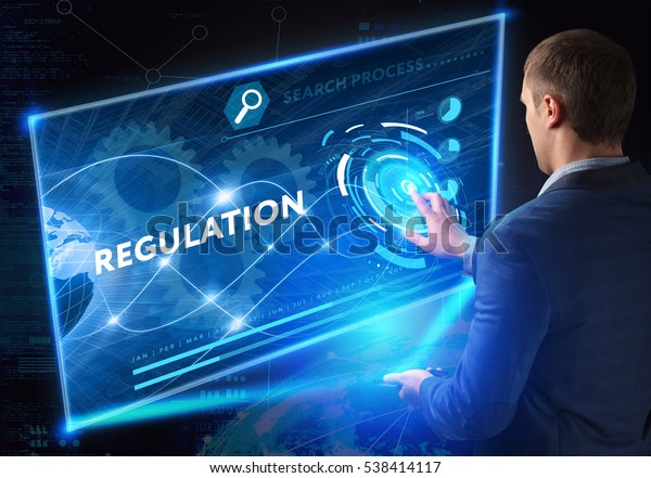 Business, Technology, Internet and network concept. Business man working on the tablet of the future, select on the virtual display: regulation