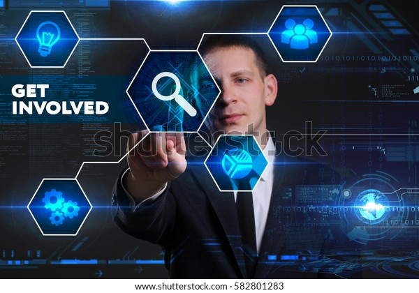 Business, Technology, Internet and network concept. Young businessman working on a virtual blackboard of the future, he sees the inscription: get involved