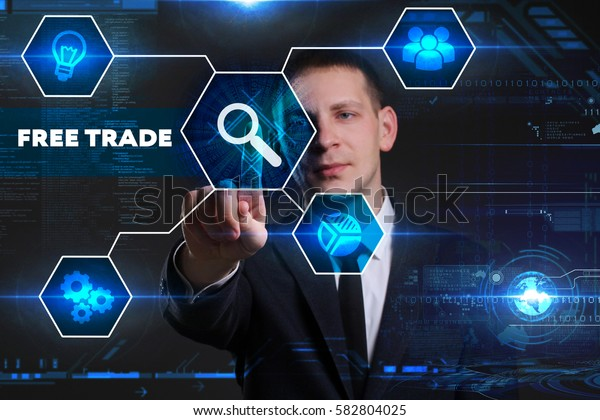 Business, Technology, Internet and network concept. Young businessman working on a virtual blackboard of the future, he sees the inscription: free trade