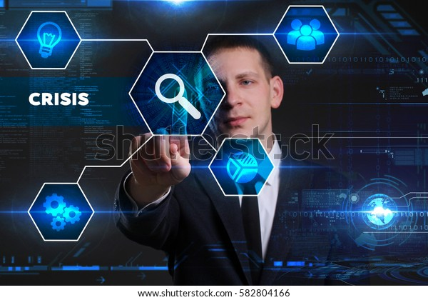 Business, Technology, Internet and network concept. Young businessman working on a virtual blackboard of the future, he sees the inscription: crisis