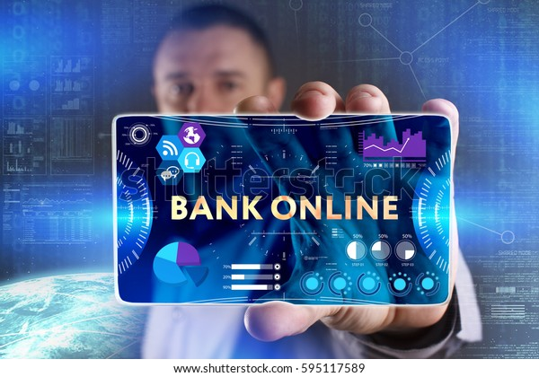 Business, Technology, Internet and network concept. Young businessman showing a word in a virtual tablet of the future: Bank online