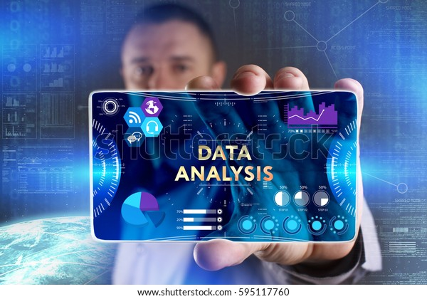 Business, Technology, Internet and network concept. Young businessman showing a word in a virtual tablet of the future: Data analysis