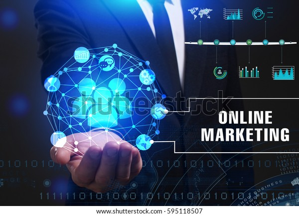 Business, Technology, Internet and network concept. Young businessman working on a virtual screen of the future and sees the inscription: Online marketing