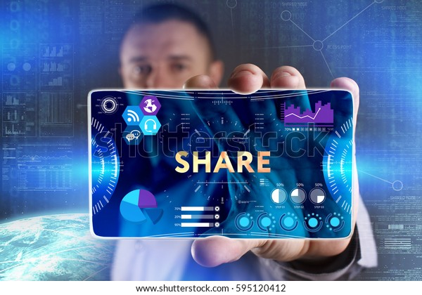 Business, Technology, Internet and network concept. Young businessman showing a word in a virtual tablet of the future: Share