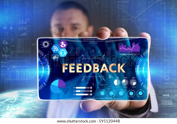 Business, Technology, Internet and network concept. Young businessman showing a word in a virtual tablet of the future: Feedback