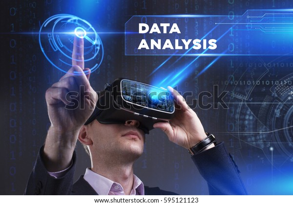 Business, Technology, Internet and network concept. Young businessman working in virtual reality glasses sees the inscription: Data analysis