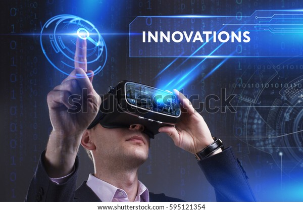 Business, Technology, Internet and network concept. Young businessman working in virtual reality glasses sees the inscription: Innovations
