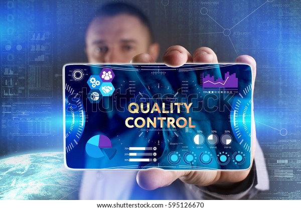 Business, Technology, Internet and network concept. Young businessman showing a word in a virtual tablet of the future: Quality control