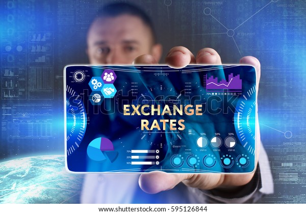 Business, Technology, Internet and network concept. Young businessman showing a word in a virtual tablet of the future: Exchange rates