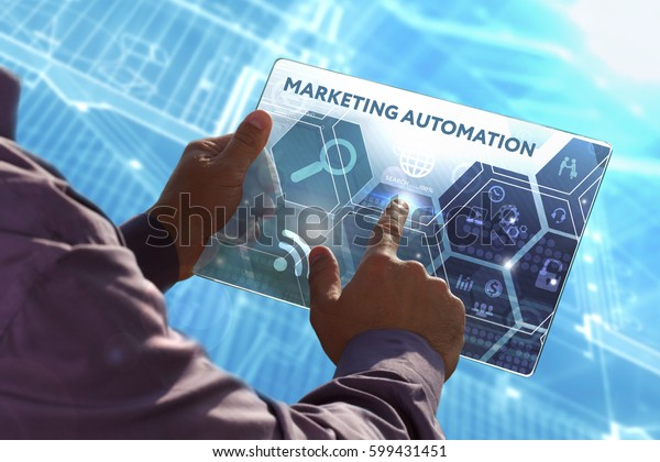 Business, Technology, Internet and network concept . Young business man working on the tablet of the future , select the virtual screen: Marketing automation