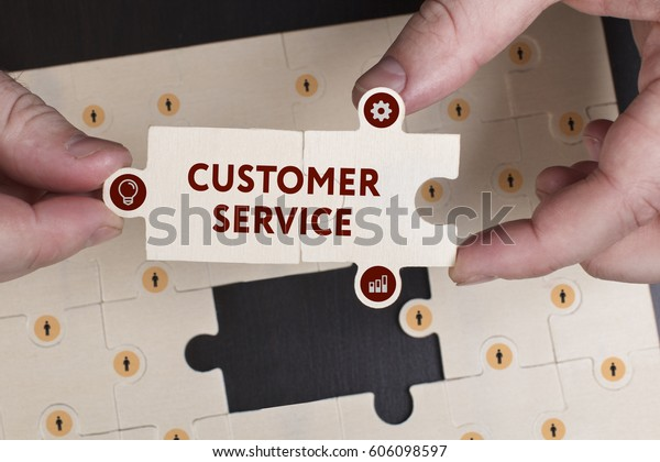 Business, Technology, Internet and network concept. Young businessman shows the word: Customer service