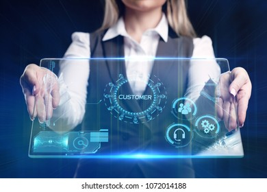 Business, technology, internet and networking concept. Young businessman working on his laptop, select the icon customer on the virtual display.