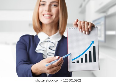 Business, technology, internet and networking concept. Young successful entrepreneur in the work process.Young entrepreneur showing blank clipboard. Success in business, job and education concept shot