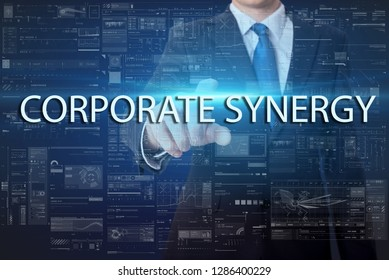 business, technology, internet and networking concept - businessman pressing virtual button with text - Corporate Synergy