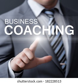 business, technology, internet and networking concept - businessman pressing business coaching button on virtual screens
