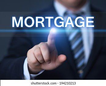 business, technology, internet and networking concept - businessman pressing mortgage button on virtual screens