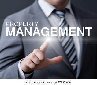 business, technology, internet and networking concept - businessman pressing property management button on virtual screens