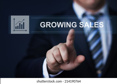 business, technology, internet and networking concept - businessman pressing growing sales button on virtual screens