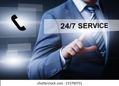business, technology, internet and networking concept - businessman pressing 24/7 service button on virtual screens