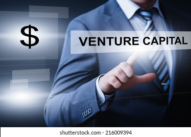 business, technology, internet and networking concept - businessman pressing venture capital button on virtual screens