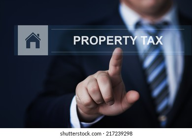 business, technology, internet and networking concept - businessman pressing property tax button on virtual screens