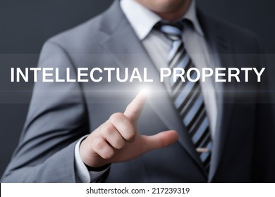 business, technology, internet and networking concept - businessman pressing intellectual property button on virtual screens