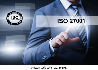 business, technology, internet and networking concept - businessman pressing iso 27001 button on virtual screens