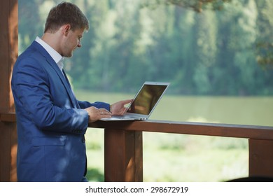 Business, technology, internet and networking concept. Young male businessman.
