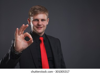 business, technology, internet and networking concept - businessman shows gesture ok