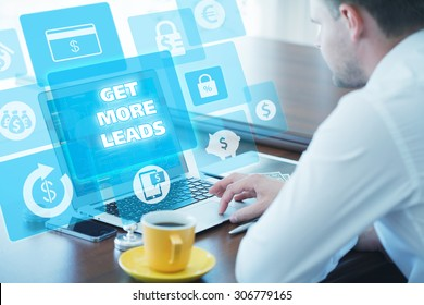 Business, technology, internet and networking concept. Young businessman working on his laptop in the office, select the icon get more leads on the virtual display.