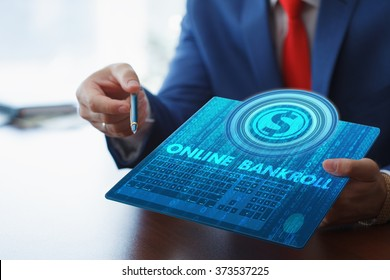 Business, technology, internet and networking concept. Young businessman working on his tablet in the office, select the icon bankroll on the virtual display.