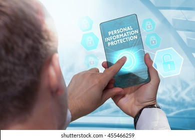 Business, technology, internet and networking concept. Young businessman working on his smartphone in the office, select the icon  personal information protection on the virtual display.
