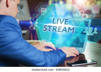 Business, Technology, Internet and networking concept. Young businessman working on his laptop of the future, working with the virtual screen hologram. The inscription on the screen: live stream.