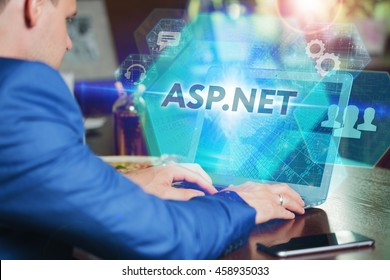 Business, Technology, Internet and networking concept. Young businessman working on his laptop of the future, working with the virtual screen hologram. The inscription on the screen: asp.net.
