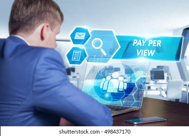 Business, technology, internet and networking concept. Young businessman working on his laptop in the office, select the icon pay per view on the virtual display.