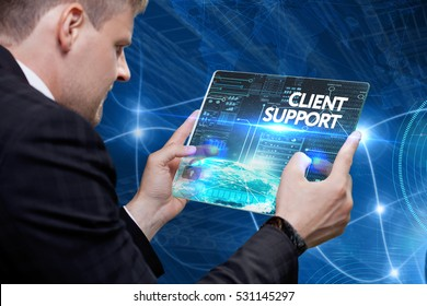 Business, technology, internet and networking concept. Young businessman working on his laptop in the office, select the icon client support on the virtual display.