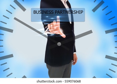 business, technology, internet and networking concept - businessman pressing business partnership button on virtual screens, blurred of blue nature outdoor bokeh background