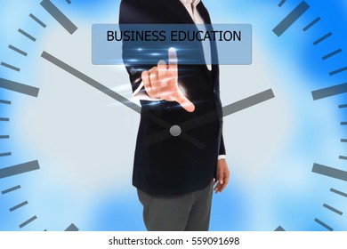 business, technology, internet and networking concept - businessman pressing business education button on virtual screens, blurred of green nature outdoor bokeh background
