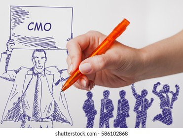 Business, technology, internet and networking concept. The girl draws a pen businessman with a poster in his hands. The sign reads: CMO