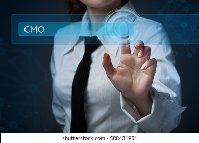 Business, technology, internet and networking concept. Business woman presses a button on the virtual screen: CMO