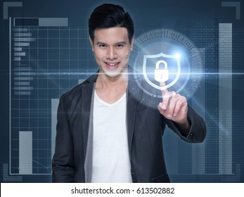 Business, technology, internet and networking concept. Young businessman touching the icon security on the virtual display.