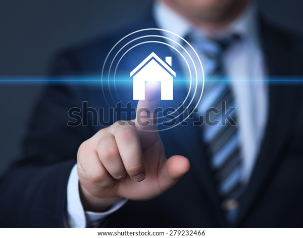business, technology, internet and networking concept - businessman pressing real estate button on virtual screens