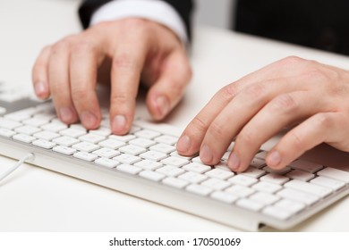 business, technology, internet and office concept - close up of businessman hands working with keyboard