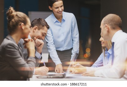 business, technology and office concept - smiling female boss talking to business team