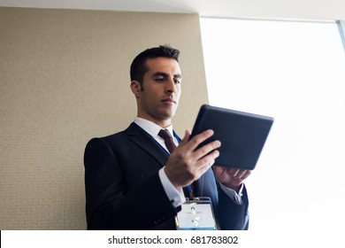 business, technology and people concept - businessman with tablet pc computer at office