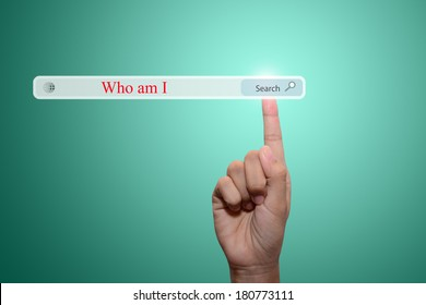 Business and technology, searching system and internet concept - male hand pressing Search Who am I button.