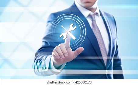 business, technology, technical support and internet concept - businessman pressing screwdriver and wrench button on virtual screens. Template for text.