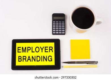 Business Term / Business Phrase on Tablet PC with a cup of coffee, Pens, Calculator, and yellow note pad on a White Background - Black Word(s) on a yellow background - Employer Branding